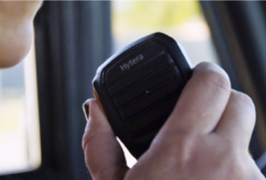 hytera two-way radio being used by a transport responder