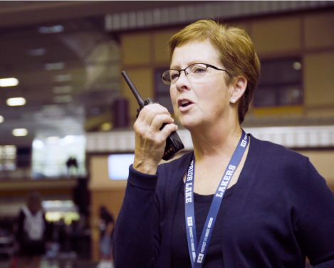 education worker using her two-way radio