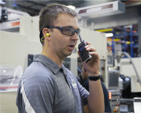manufacturer worker using his two-way radio