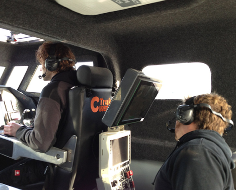 two flight control technicians working with handsfree headsets