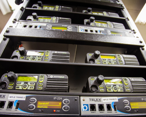 stacks of custom designed radio dispatch systems