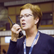 education worker talking on a two-way radio