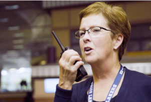 education worker on her two-way radio