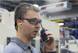 manufacturer worker on his two-way radio